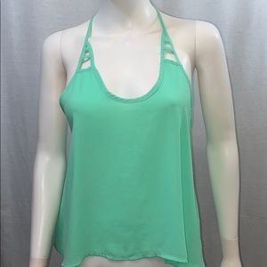 Mint green Guess cropped tank caged detail on back